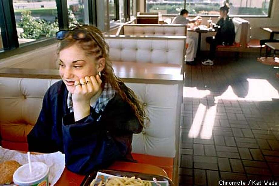 9th Grader, Michelle Webber,15, (left) sits in Burger King on Railroad Avenue while cutting her 5th period class at Pittsburg High School to eat lunch with her friend Jessica Delatorre, 15. (SAN FRANCISCO CHRONICLE PHOTO BY KAT WADE) Photo: KAT WADE