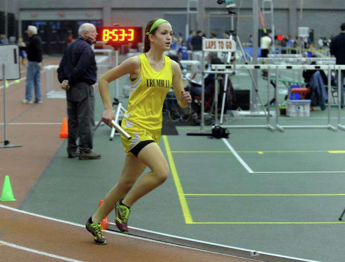Trumbull's Lindsey Gilson competes in the 4X800 relay, during FCIAC Track Championship action at the New Haven Athletic Center in New Haven, Conn. on Thursday February 2, 2012.