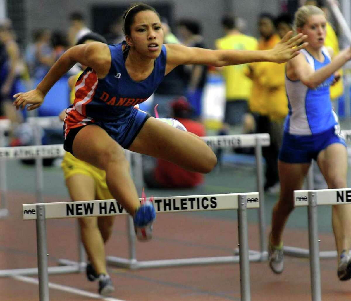 Danbury's Sarah Hicks competes in the hurdles, during FCIAC Track Championship action at the New Haven Athletic Center in New Haven, Conn. on Thursday February 2, 2012.