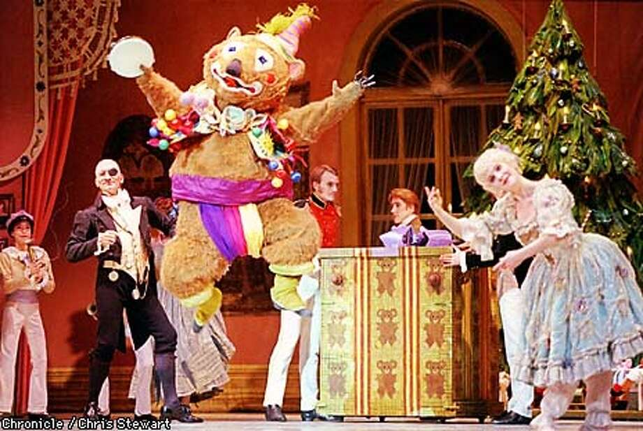 Herr Drosselmeyer, played by Jim Sohm (left w/ eye patch), is entertained by a leaping bear and dancing life-sized wind-up doll in the annual production of the Nutcracker as performed by the San Francisco Ballet.  BY CHRIS STEWART/THE CHRONICLE Photo: CHRIS STEWART