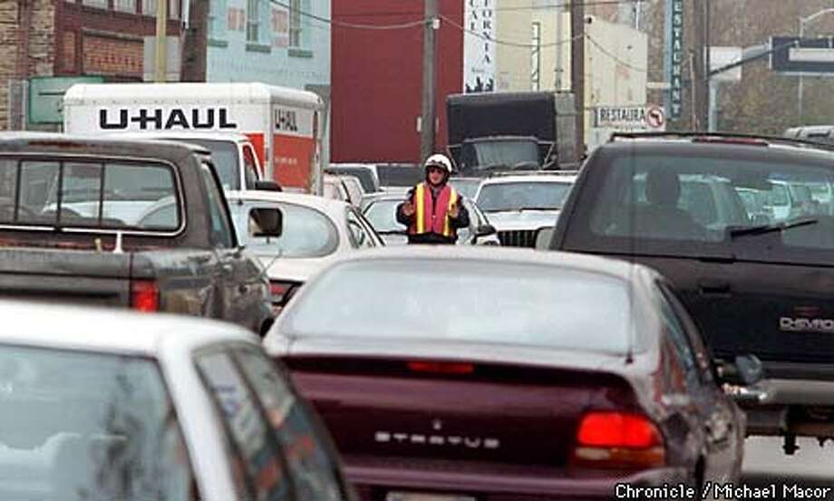 Traffic control Officer James Fahey is lost in a sea of cars at the corner of 6th St. and Bryant as he directs traffic. Hugh power outage in SF knocked out the power to traffic lights. by Michael Macor/The Chronicle Photo: MICHAEL MACOR