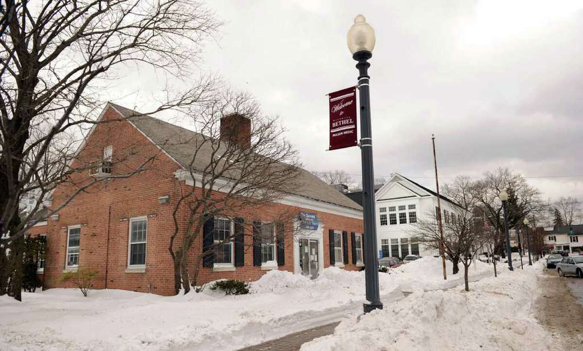 The brick building on the left, next to the Bethel Public Library, is the old town hall. It also used to house the Bethel teen center. Photo taken Tuesday, Dec. 28, 2010