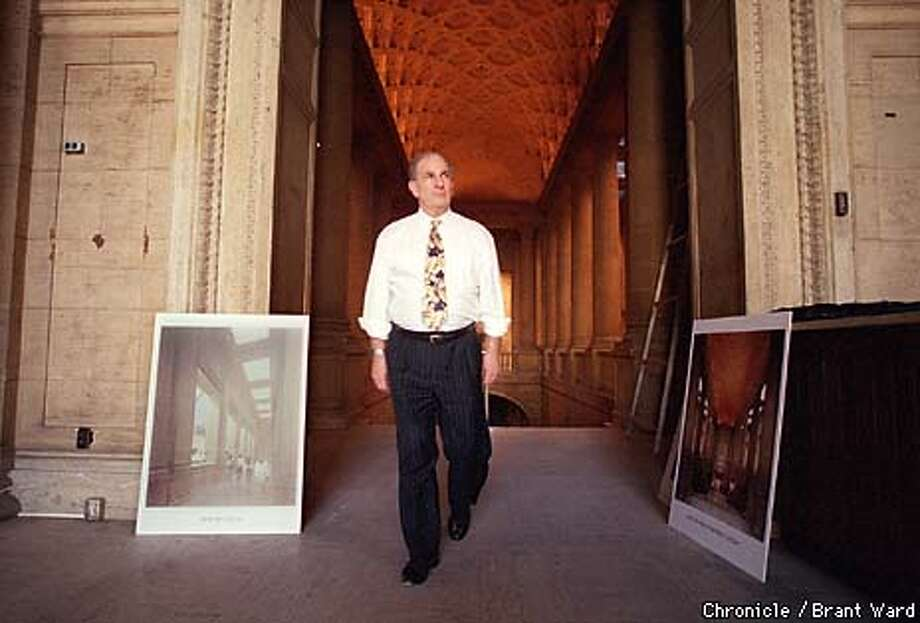MURALS1/09DEC98/MN/BW--Asian Museum project director Jim Killoran led a tour of the old main library which will be transformed into the new Asian Museum. He will try to convince the Planning Commission to remove the murals. By Brant Ward/Chronicle Photo: BRANT WARD