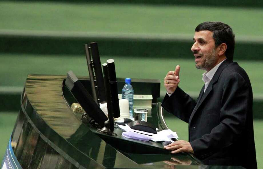 Iranian President Mahmoud Ahmadinejad addresses parliament before presenting his proposed budget in Tehran on February 1, 2012. A raft of Western economic sanctions on Iran over its controversial nuclear programme are increasingly stifling the lives of ordinary Iranians, hit by rising inflation and growing isolation.      AFP PHOTO/STR (Photo credit should read -/AFP/Getty Images) Photo: -