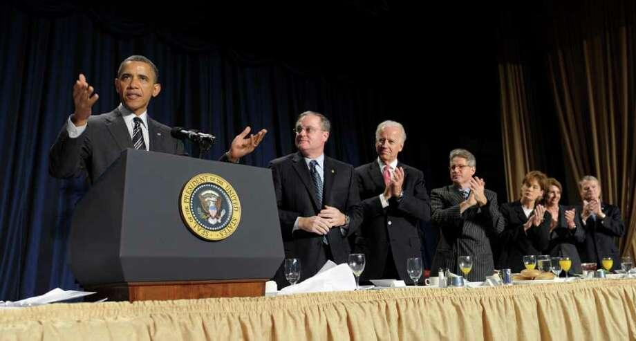 President Barack Obama gestures while speaking at the National Prayer Breakfast in Washington, Thursday, Feb. 2, 2012. (AP Photo/Susan Walsh) Photo: Susan Walsh