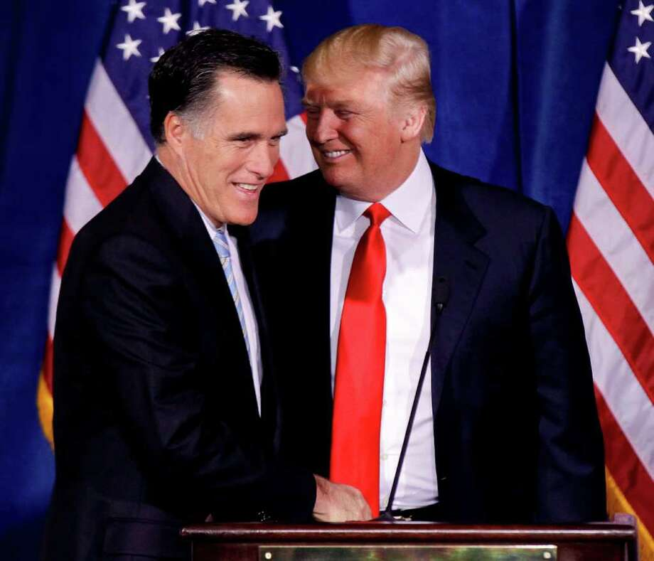 Donald Trump greets Republican presidential candidate, former Massachusetts Gov. Mitt Romney, after announcing his endorsement of Romney during a news conference, Thursday, Feb. 2, 2012, in Las Vegas.  (AP Photo/Julie Jacobson) Photo: Julie Jacobson