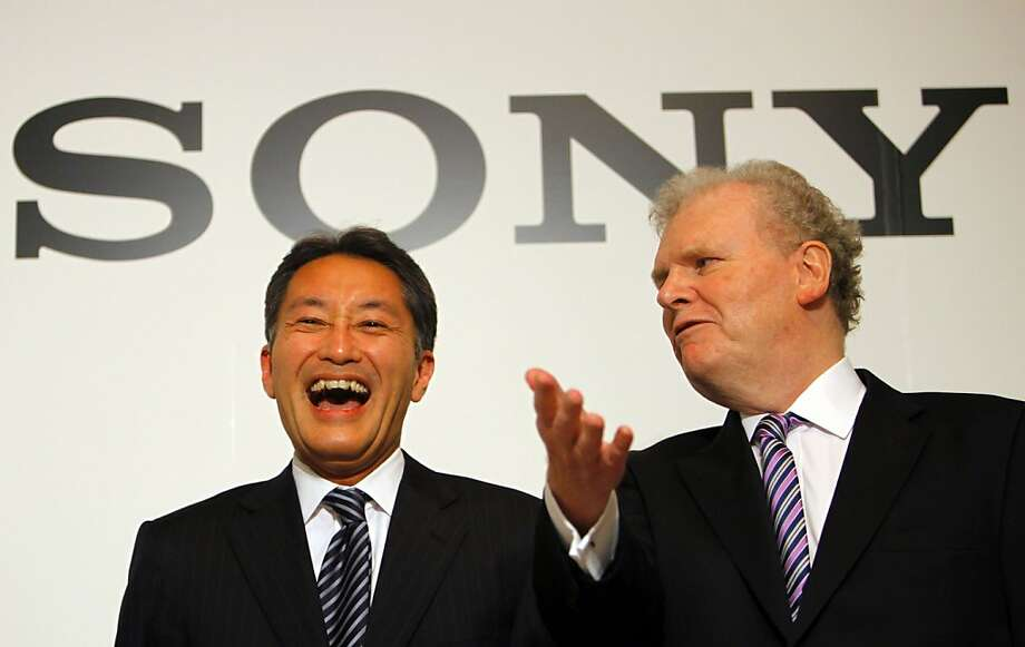Sony Corp. President and Chief Executive Officer to be Kazuo Hirai, left, and current Sony CEO Howard Stringer have a light moment at a photo session following their press conference Thursday, Feb. 2, 2012. Battered by weak TV sales, a strong yen and production disruptions from flooding in Thailand, the Japanese electronics and entertainment company on Thursday reported a net loss of 159 billion yen ($2.1 billion) for the October-December quarter and projected it would lose even more money for the full fiscal year than it had expected three months ago. Sony announced Wednesday that Hirai will replace Stringer as CEO and president effective April 1. (AP Photo/Junji Kurokawa) Photo: Junji Kurokawa, Associated Press