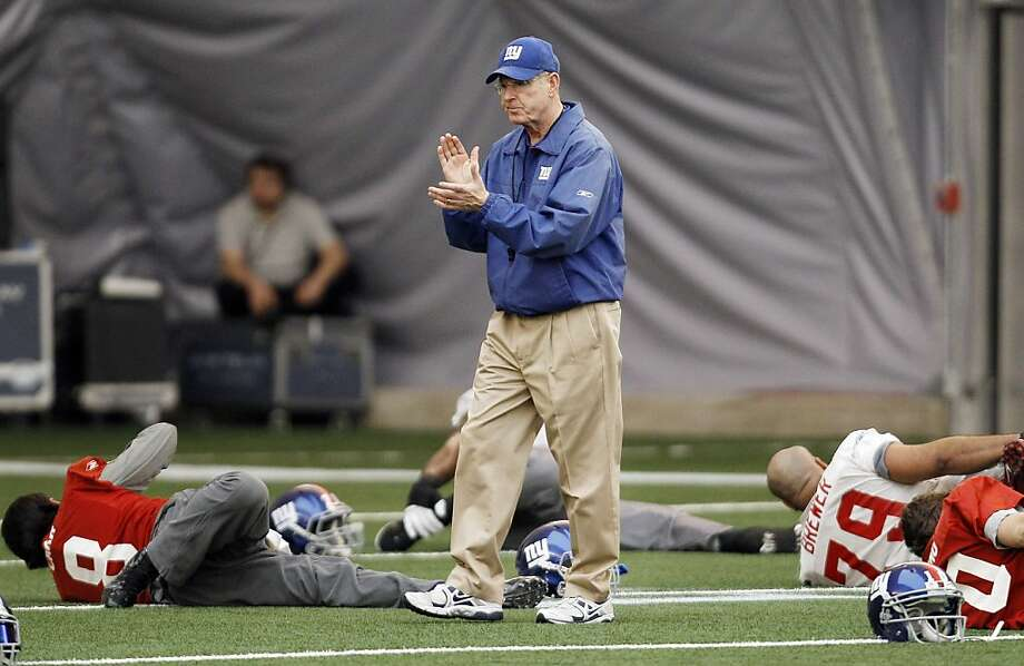 New York Giants head coach Tom Coughlin watches over practice practice, Wednesday, Feb. 1, 2012, in Indianapolis. The Giants will face the New England Patriots in the NFL football Super Bowl XLVI  on Feb. 5.(AP Photo/Eric Gay) Photo: Eric Gay, Associated Press