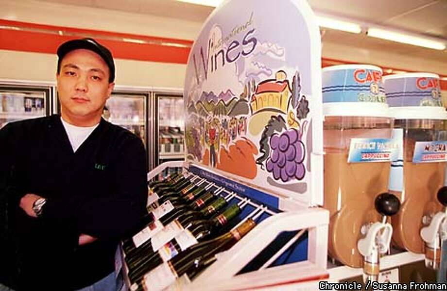 =Jin An, owner of a 7-Eleven store on Piedmont Avenue in Oakland, has set up a new wine display rack in his store. BY SUSANNA FROHMAN/THE CHRONICLE Photo: SUSANNA FROHMAN