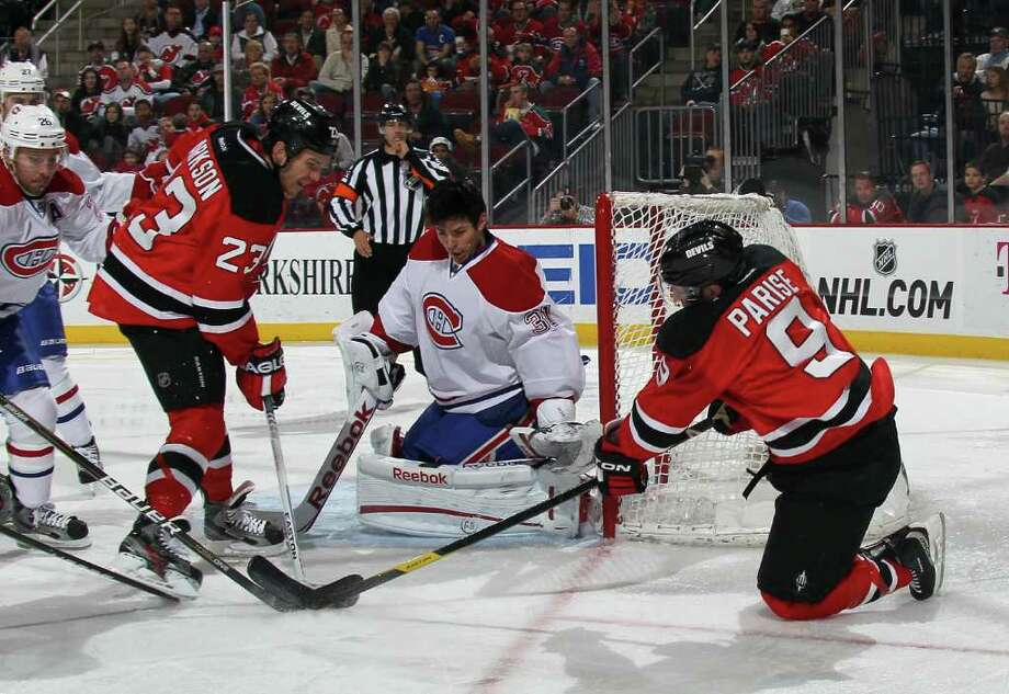 NEWARK, NJ - FEBRUARY 02: David Clarkson #23 and Zach Parise #9 of the New Jersey Devils attempt to score on Carey Price #31 of the Montreal Canadiens at the Prudential Center on February 2, 2012 in Newark, New Jersey.  (Photo by Bruce Bennett/Getty Images) Photo: Bruce Bennett