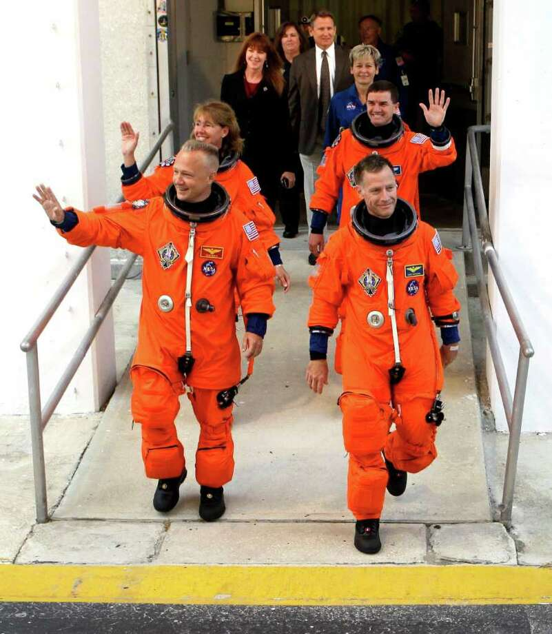 The Atlantis crew heads for the launch pad at the Kennedy Space Center on July 8. Atlantis was NASA's 135th and final space shuttle launch. Photo: John Raoux, Associated Press