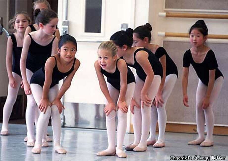 "Budding ballerinas await their cue as they prepare for their roles as ""Mother Ginger's Children"" in SF Ballet's 1998 production of ""The Nutcracker."" Rehearsal hall at SF Ballet - 455 Franklin Street BY JERRY TELFER/THE CHRONICLE Photo: JERRY TELFER"
