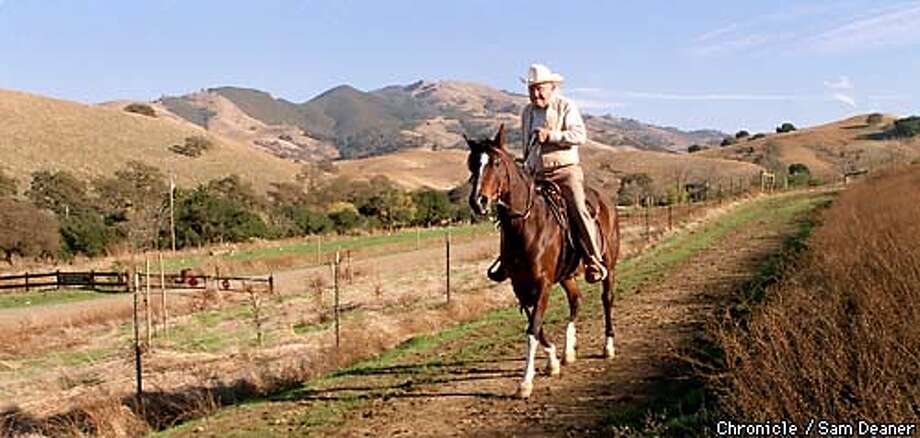 """- George Cardinet, 89, trail-rides on 15-year-old Arabian horse """"Sensation"""" in the beautiful setting of Mt. Diablo Wednesday in Walnut Creek. Cardinet is the driving force behind the vast trails for horses and hikers on Mt. Diablo. (CHRONICLE PHOTO/SAM DEANER) Photo: SAM DEANER"""