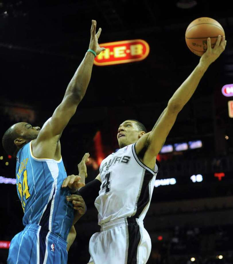 Danny Green of the San Antonio Spurs shoots over Carl Landry of the New Orleans Hornets at the AT&T Center on Thursday, Feb. 2, 2012.  Billy Calzada / San Antonio Express-News