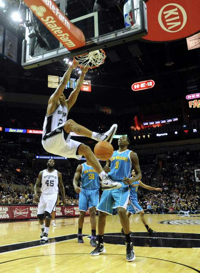 Richard Jefferson of the San Antonio Spurs dunks during first-half NBA action against the New Orleans Hornets at the AT&T Center on Thursday, Feb. 2, 2012.  Billy Calzada / San Antonio Express-News