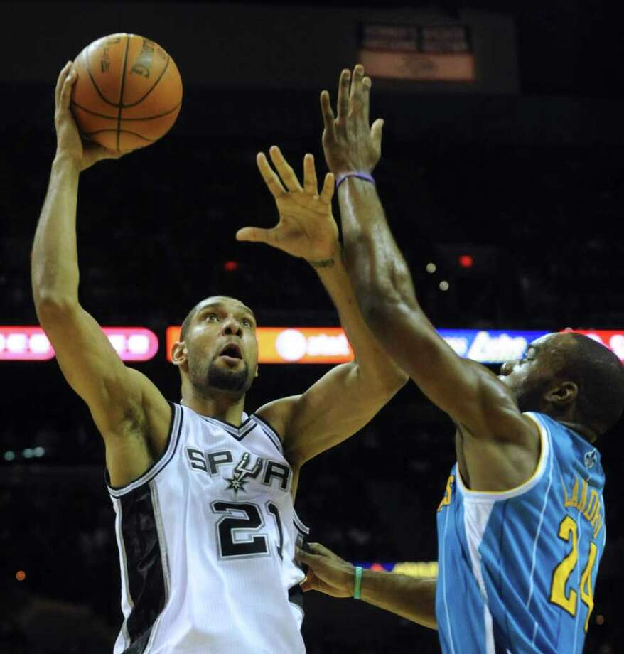 Tim Duncan of the San Antonio Spurs shoots over Carl Landry of the New Orleans Hornets during NBA action at the AT&T Center on Thursday, Feb. 2, 2012.  Billy Calzada / San Antonio Express-News