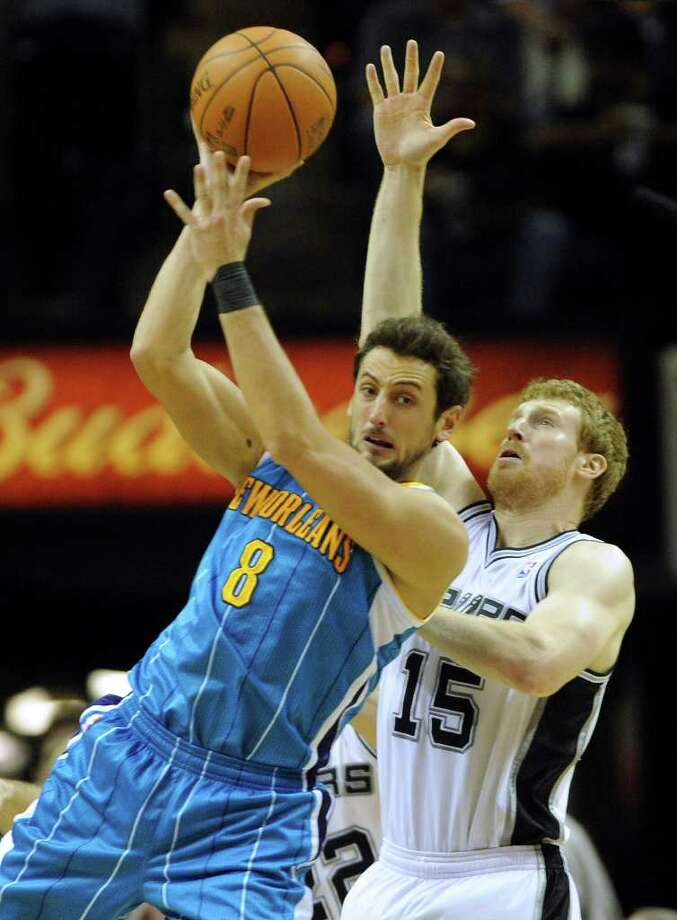 Matt Bonner (15) of the Spurs defends Marco Belinelli of New Orleans looks to pass off during NBA action on Thursday, Feb. 2, 2012.  Billy Calzada / San Antonio Express-News