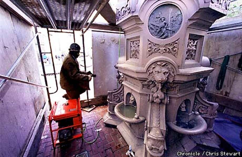 Iron worker Thomas Brooks carries to safe place one of the 200 pieces of Lotta's Fountain, being dismantled prior to restoration. The 24-foot-tall cast iron fouintain, dedicated on September 9, 1875, is being removed from an island at the corner of Kearney, Geary and Market streets and will be examined, cleaned, repaired and recast, if necessary, before reassembly on the same island in April of 1999. The San Francisco Art Commission will begin restoration November 30 on the monument, the oldest surviving monument in San Francisco. It was a gift to the city from famed actress Lotta Crabree.  BY CHRIS STEWART/THE CHRONICLE Photo: CHRIS STEWART