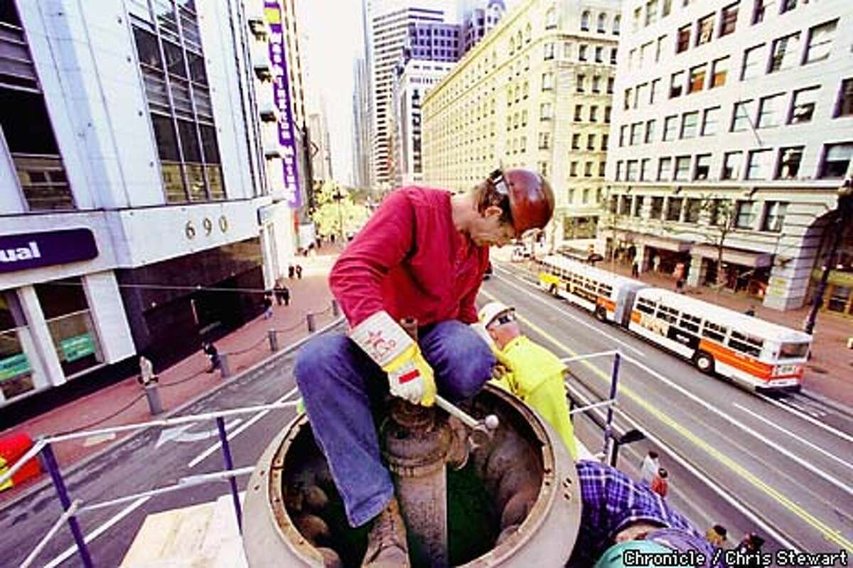An ironworker on top of Lotta's fountain. Chronicle Photo by Chris Stewart