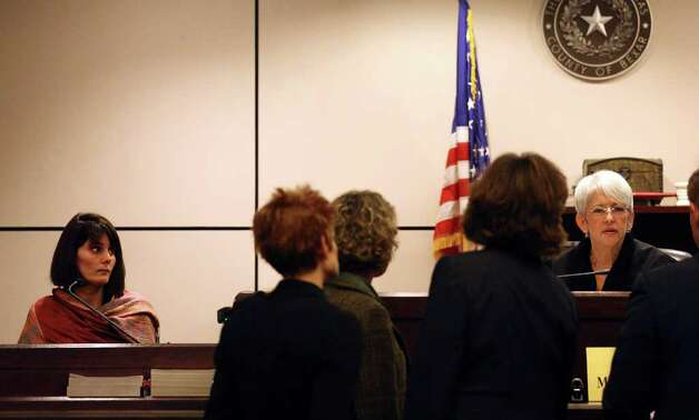 Melissa Federspill (left) watches from the witness stand as attorneys confer with Judge Maria Teresa Herr during the murder trial of Jon Thomas Ford in the 186th District Court at the Bexar County Justice Center, Thursday, Feb. 2, 2012. Ford is accused of killing his ex-girlfriend Dana Clair Edwards, 32, on New Year's Day 2009. Federspill said Ford acted strange at the New Year's Eve party. Photo: Jerry Lara, San Antonio Express-News / © San Antonio Express-News