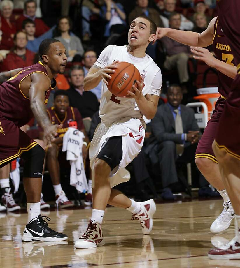 Stanford guard Aaron Bright (2) drives to the basket in front of Arizona State forward Kyle Cain, left, in the first half of an NCAA college basketball game in Palo Alto, Calif., Thursday, Feb. 2, 2012. (AP Photo/Paul Sakuma) Photo: Paul Sakuma, Associated Press