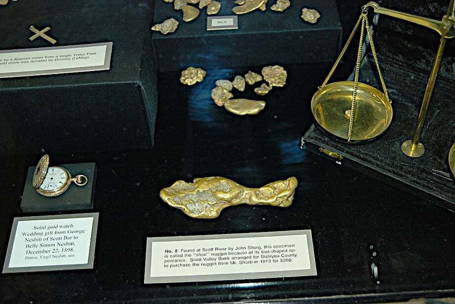 "In this Dec. 13, 2006 photo provided by Mel Fechter is a lobby display case of gold nuggets at the Siskiyou County Courthouse in Yreka, Calif.  Shown in the foreground is the keystone of the exhibit, a 28-ounce nugget that is known as the ""shoe"" or  ""slipper."" Thieves broke into the courthouse early Wednesday, Feb. 1, 2012 and stole gold pieces from the display whose total value is estimated at $3 million. County officials and historical experts say the theft of the collection represents an ""irreplaceable"" loss to the county's cultural identity and past. (AP Photo/Mel Fechter) Photo: Mel Fechter, Associated Press"