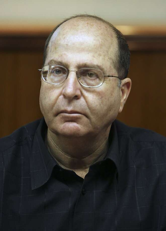 FILE - In this Sunday, Aug. 23, 2009 file photo, Israel's deputy prime minister and minister of strategic affairs Moshe Ya'alon attends the weekly cabinet meeting at the Prime Minister's office in Jerusalem. Iran's suspected nuclear weapons installations are vulnerable to possible military strikes, Yaalon warned Thursday, Feb. 2, 2012, suggesting that underground bunkers don't offer sufficient protection.(AP Photo/Jim Hollander, File) Photo: Jim Hollander, Associated Press