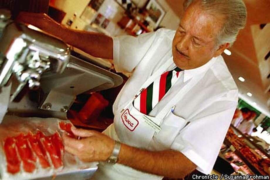 Dominic DeVincenzi slices meat at Genova Deli in Oakland. (CHRONICLE PHOTO BY SUSANNA FROHMAN) Photo: SUSANNA FROHMAN