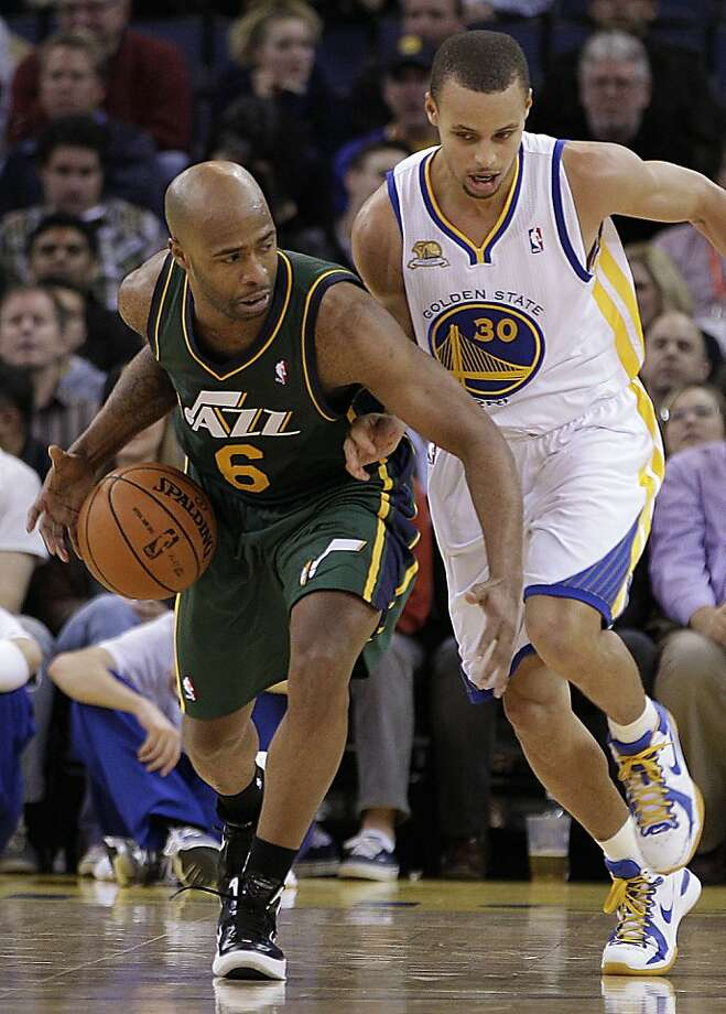 Utah Jazz guard Jamaal Tinsley (6) drives against Golden State Warriors' Stephen Curry (30) during the first half of an NBA basketball game on Thursday, Feb. 2, 2012, in Oakland, Calif. Photo: Ben Margot, Associated Press