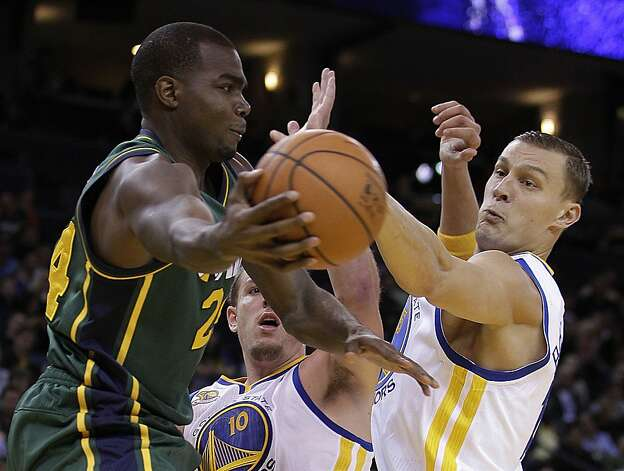 Utah Jazz forward Paul Millsap, left, passes around from Golden State Warriors' David Lee (10) and Andris Biedrins during the first half of an NBA basketball game Thursday, Feb. 2, 2012, in Oakland, Calif. Photo: Ben Margot, Associated Press