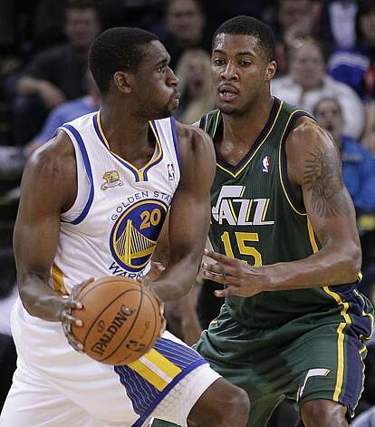 Golden State Warriors' Ekpe Udoh, left, looks to pass away from Utah Jazz forward Derrick Favors during the first half of an NBA basketball game Thursday, Feb. 2, 2012, in Oakland, Calif. Photo: Ben Margot, Associated Press