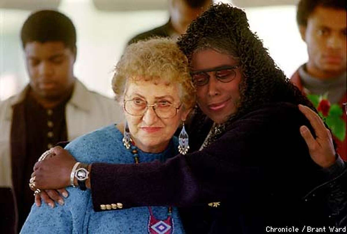 JOONESTOWN2/18NOV98/MN/BW--Survivors of Jim Jones and Jonestown, Neva Sly, left, and Yulanda Williams were reunited at the 20th anniversary memorial held in Oakland Wednesday. Yulanda escaped through the jungle. Neva got out but lost her husband. By Brant Ward/Chronicle
