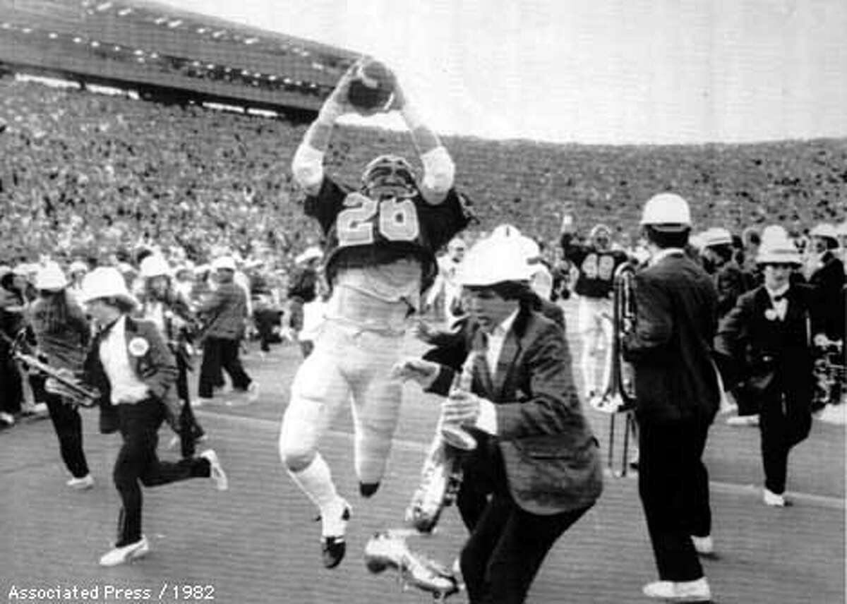 BIGGAME-1982b/B/13NOV97/MN/AP--Cal's Kevin Moen (26) leaps with the ball in the air after scoring Cal's winning touchdown while the Stanford bank runs to get out of his way on November 25, 1982. PHOTO BY THE ASSOCIATED PRESS