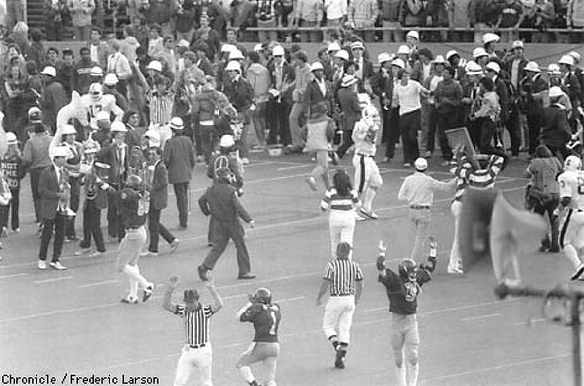 BIGGAME-THE PLAY/B/13NOV97/MN/FL--This is the overall scene of the field as Cal Berkeley scored against Stanford in the final seconds of the Big Game in 1982 to win. The scoreboard had seconds still on the clock when the Cal Band marched onto the field, getting in the way of the Cal Player making the touchdown. The touchdown became known as