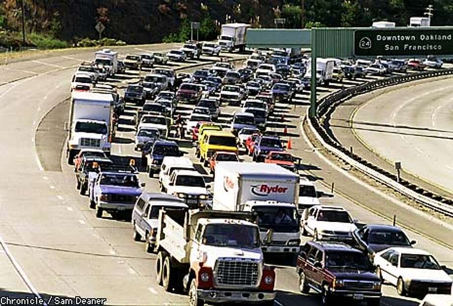 Highway 24 Eastbound turned into a parking lot Thursday morning when a multi-car crash at the east end of the Caldecott Tunnell snarled eastbound traffic which backed up more than a mile. At the same time a two car collision in the Westbound lanes on the east end of the tunnell backed up traffic to the Orinda BART station crippling the morning commute. (CHONICLE PHOTO / SAM DEANER) Photo: SAM DEANER