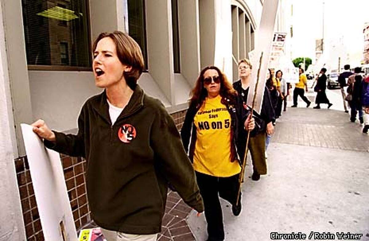 Elaine Peterson of Oakland marches with opponents of Propositon 5 outside the San Francisco Chronicle because the Chronicle endorsed the Proposition. BY ROBIN WEINER/THE CHRONICLE
