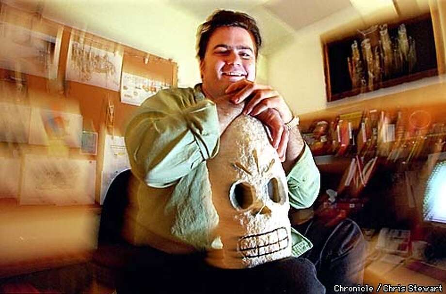 "Tim Schafer, game designer for LucasArts in San Rafael, poses with a skull from his latest game, ""Grim Fandango."" Schafer is photographed in his office at LucasArts, 1600 Los Gamos Drive.  BY CHRIS STEWART/THE CHRONICLE Photo: CHRIS STEWART"