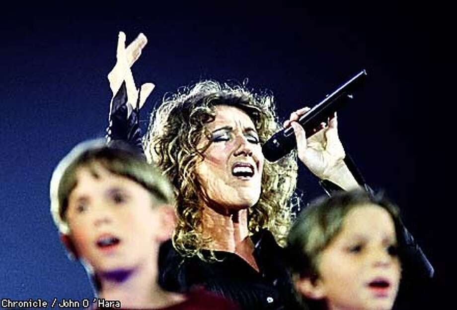 Canadian-born chanteuse Celine Dion performs with a group of local school children at the Oakland Coliseum Arena.  BY JOHN O'HARA/THE CHRONICLE Photo: JOHN O'HARA