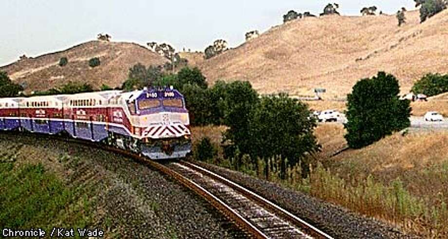 The Altamont Commuter Express test train whips past traffic on highway 680 near Pleasaton-Sunol Road in Pleasanton Thursday evening at 6:38 pm. SAN FRANCISCO CHRONICLE PHOTO BY KAT WADE Photo: KAT WADE