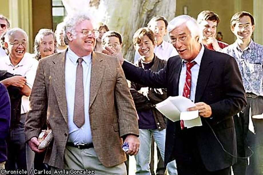 Stanford Professor, Robert Laughlin, and University President Gerhard Caspar joke around during an afternoon gathering celebrating Laughlin's being awarded of the Nobel Prize in Physics along with two other scientists on Tuesday, October 13, 1998. About one hundred and fifty student, faculty, staff, and Stanford dignitaries attended the celebration. (CHRONICLE PHOTO BY CARLOS AVILA GONZALEZ) Photo: CARLOS AVILA GONZALEZ