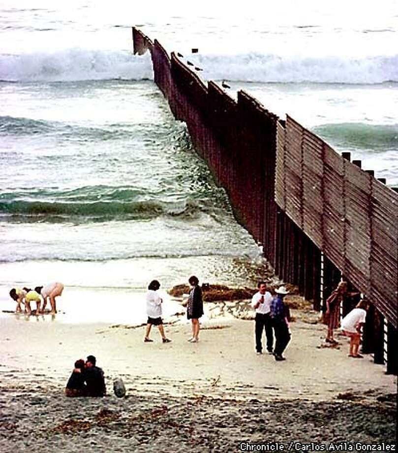 The beach at Playas De Tijuana, where tourists come to play, kiss, and to look through the border wall at the Unites States, a destination dream to those wanting a better life in the United States. (CHRONICLE PHOTO BY CARLOS AVILA GONZALEZ) Photo: CARLOS AVILA GONZALEZ