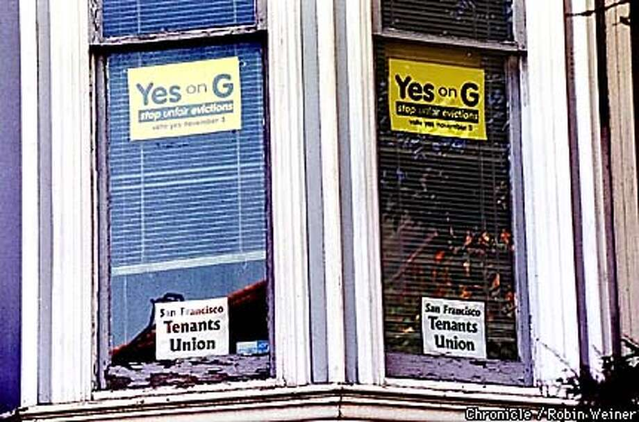 Two signs supporting Proposition G, a tenant-sponsored measure that would permanently and severly limit owner move-in evictions and end tenancies-in-common, a technique used by renters to buy buildings but that also shrinks the available pool of rental units, hang on windows of the San Francisco Tenants Union in the Mission neighborhood.  BY ROBIN WEINER/THE CHRONICLE Photo: ROBIN WEINER