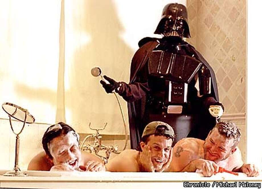 From left, Complete Pandemonium filmmakers Mark Dippe, Clint Goldman and Steve Williams clown around playing in a tub with Lucas Film's Darth Vader. The three made a clean break from Lucas Films to start their own successful business.  BY MICHAEL MALONEY/THE CHRONICLE Photo: MICHAEL MALONEY