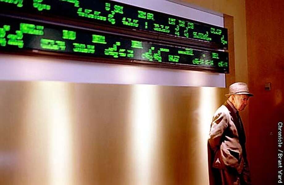 MARKET1/08OCT98/BU/BW--At Charles Schwab, longtime investor Max Hochhausen waited for his turn to use the computers to look up quotes in the lobby of the San Francisco brokerage. Max isn't exactly worried about market fluctuations as he bought his stocks years ago. By Brant Ward/Chronicle Photo: BRANT WARD
