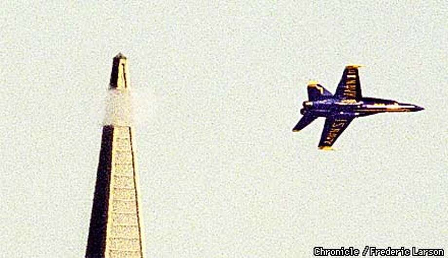 : A Navy's Blue Angels planes apprears to be taking the top off the TransAmerican Pyramid during a practice outing in prepartation for this week-ends air show over the SF Bay. Chronicle photo by Frederic Larson. Photo: FREDERIC LARSON