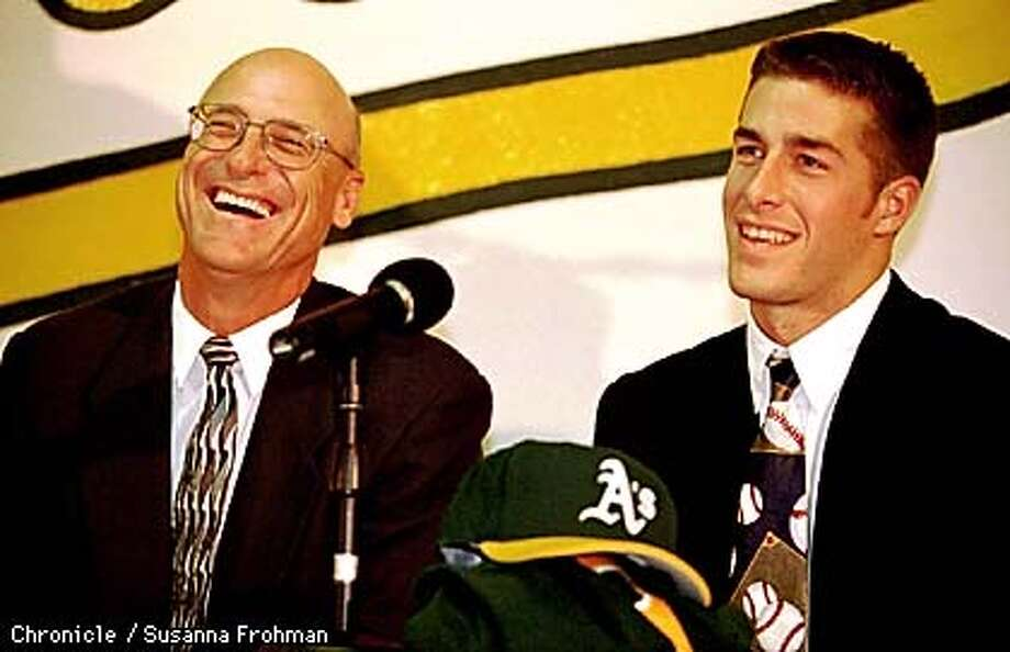 A's Manager Art Howe, left and pitcher Mark Mulder, the A's top draft pick, laugh during a press conference held Wednesday afternoon at the Network Associates Coliseum to annouce Howe's resigning and Mulder's signing. (CHRONICLE PHOTO BY SUSANNA FROHMAN) Photo: SUSANNA FROHMAN