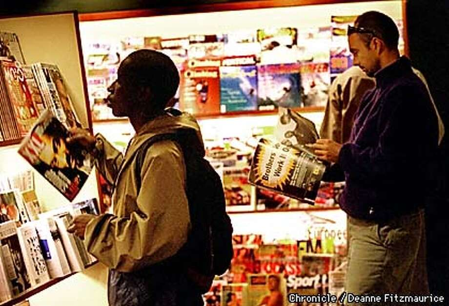 People browse through magazines at Stacey's Bookstore on Market Street during lunchtime. Cal-West Periodicals is going out of business which could mean that Stacey's will need to find another distributor. CHRONICLE PHOTO BY DEANNE FITZMAURICE Photo: DEANNE FITZMAURICE