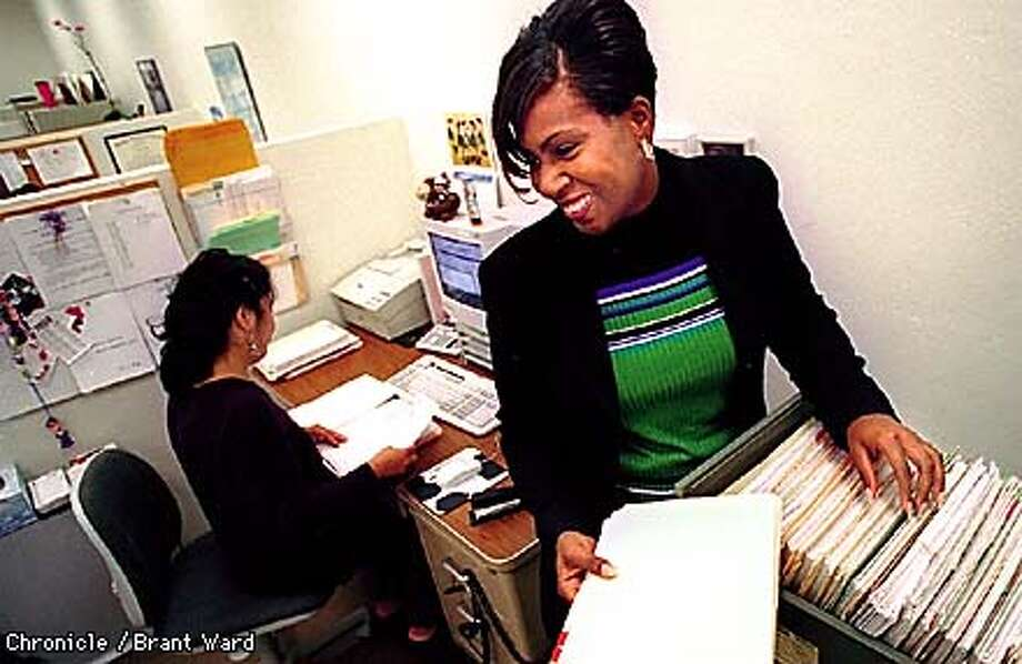 SMALL BIZ1/01OCT98/BU/BW--Kimberly Hill filed some papers at CAL Insurance where she works as an administrative assistant. By Brant Ward/Chronicle Photo: BRANT WARD