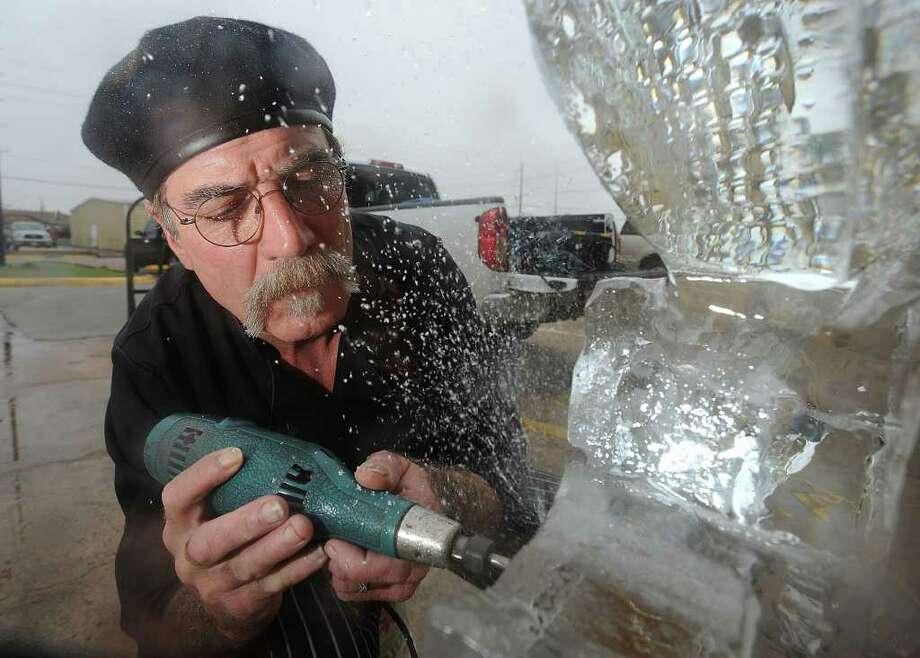 Tommy Thompson carves out 'SUPER BOWL' from a block of ice that will be used as an ice sculpture at party on Sunday. Thompson uses a chainsaw, drills and an iron to work 300 pounds blocks of ice into artistic sculptures. Photo taken February 2, 2012 Guiseppe Barranco/The Enterprise Photo: Guiseppe Barranco, STAFF PHOTOGRAPHER / The Beaumont Enterprise