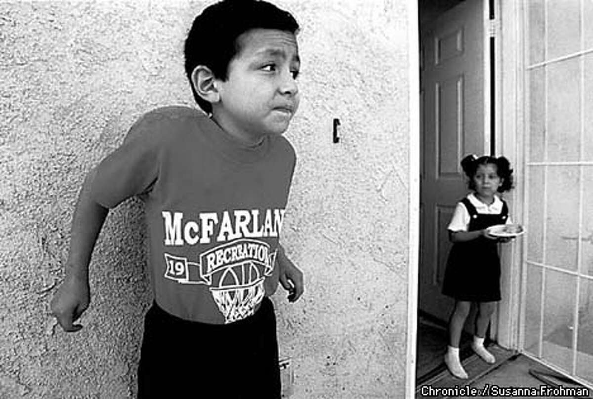 =Seven year-old Ivan Marquez leans against a basketball outside of his McFarland home. Marquez was diagnosed with Acute Lymphoblastic Leukemia in April, 1995. Although his cancer is in remission, his mother still tries to keep him from playing basketball in the sun because it usually takes him several days to recover. BY SUSANNA FROHMAN/THE CHRONICLE